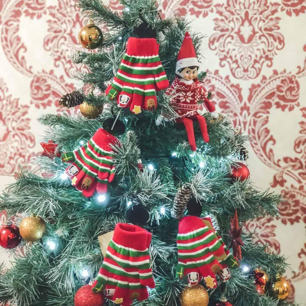 Elf On The Shelf Ideas - elf brings Christmas gloves